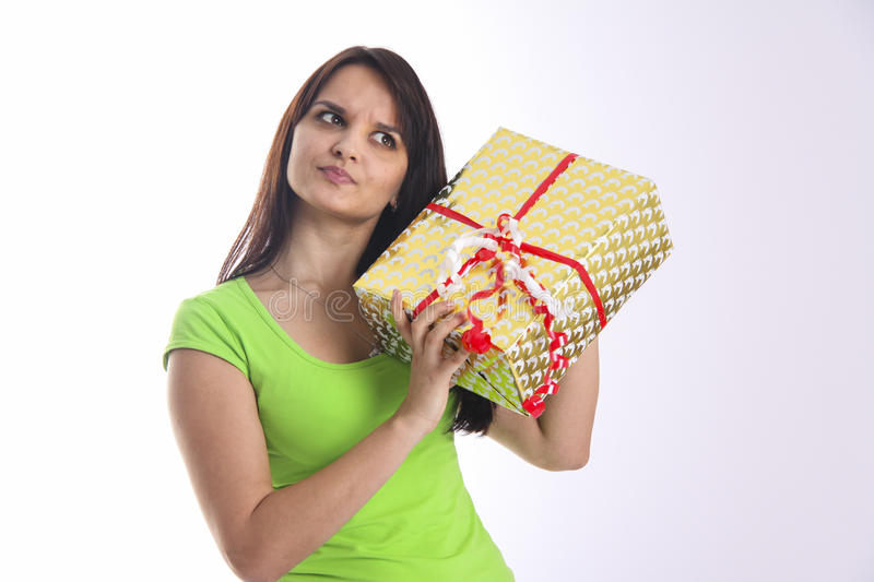 Girl wants to know what is in box royalty free stock photo