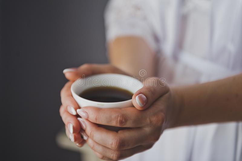 The girl warm palms on his Cup of coffee 8876. royalty free stock photo