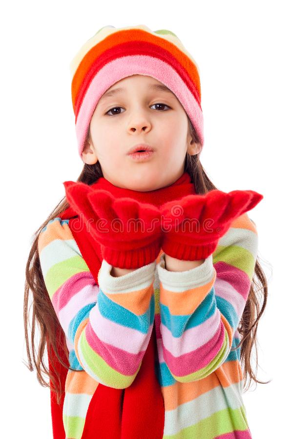 Girl in warm winter clothes blowing to hands stock images