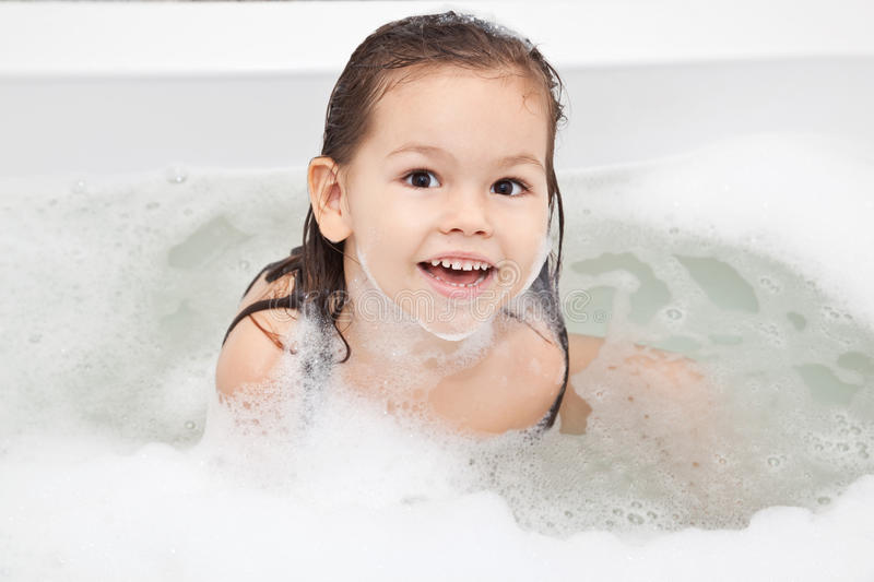 The Girl washes in the bathroom royalty free stock image