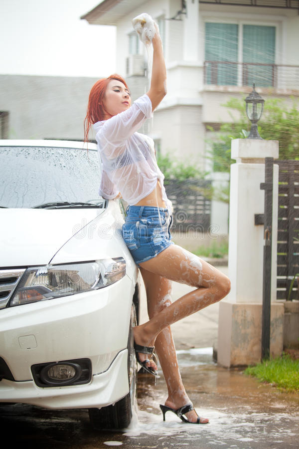 Girl washing a car royalty free stock image