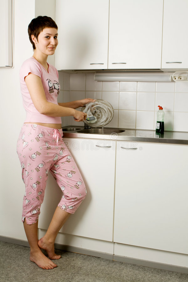 Girl Washing The Plate stock image