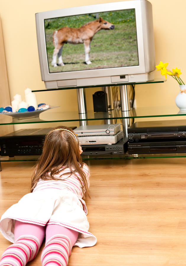 Girl watches TV stock photography
