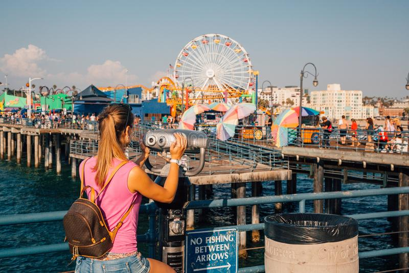 Girl watching amusement park at the Santa Monica pier stock photo