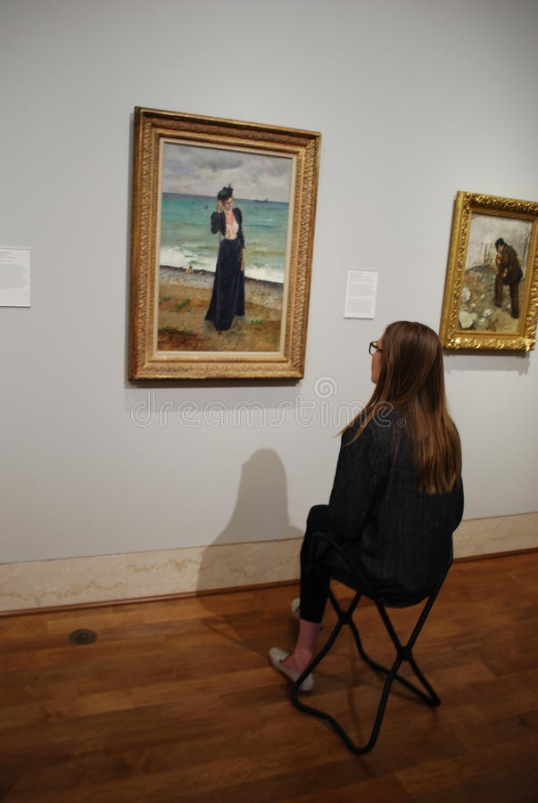 Girl watching on the art picture at museum royalty free stock image