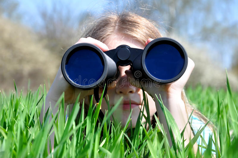 Girl Watching Binoculars Royalty Free Stock Photos