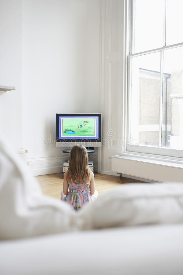 Girl Watching Cartoons In TV At Home stock illustration