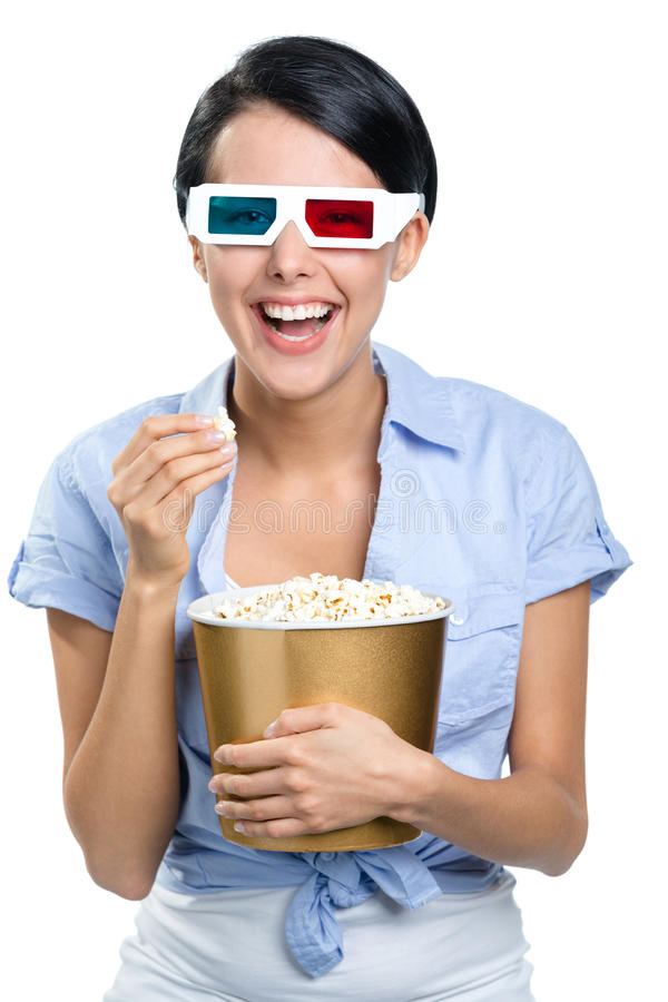 Girl watching 3D movie with popcorn royalty free stock photos