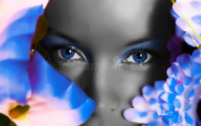 Download Girl Watching Through Flowers Stock Photo - Image: 13314146