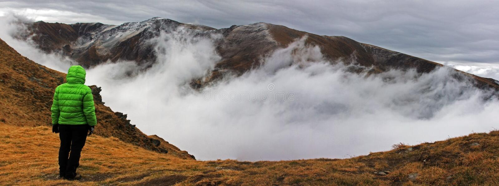 Girl watching the fog rising from the valley royalty free stock image