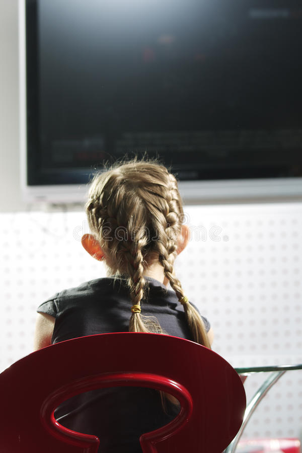 Girl watching television royalty free stock photo