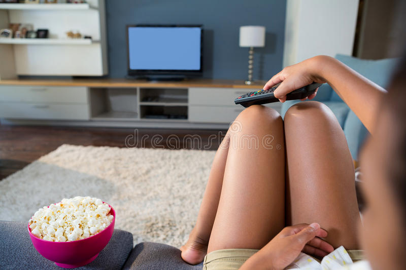 Girl watching television at home royalty free stock image