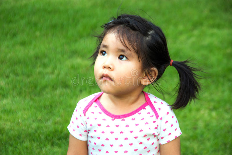 Girl watching upper with green background stock photography