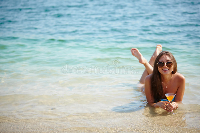 Girl in water stock image