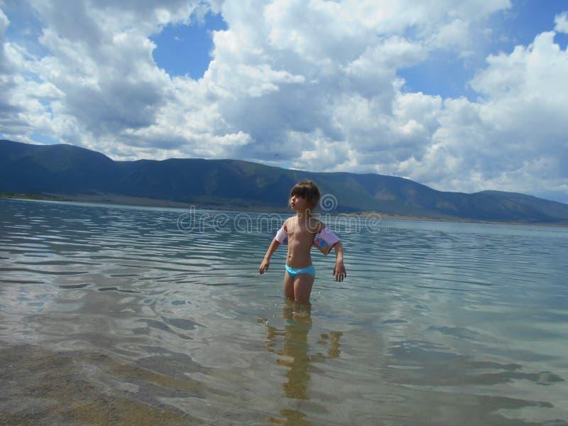 Girl in water. stock image