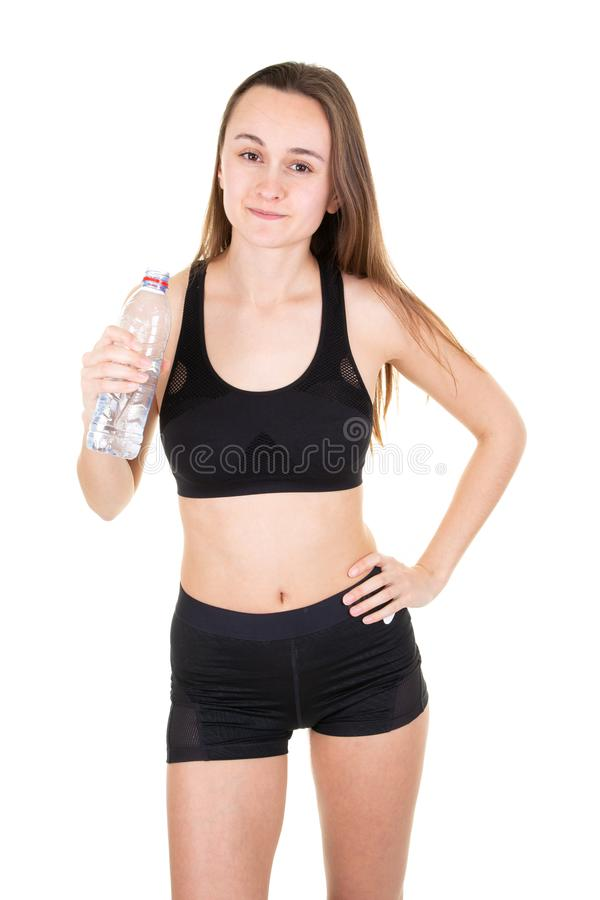 Girl with water bottle concept of healthy nutrition and sport lifestyle isolated over white background royalty free stock photos