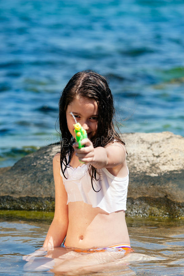 Girl with the water gun royalty free stock image