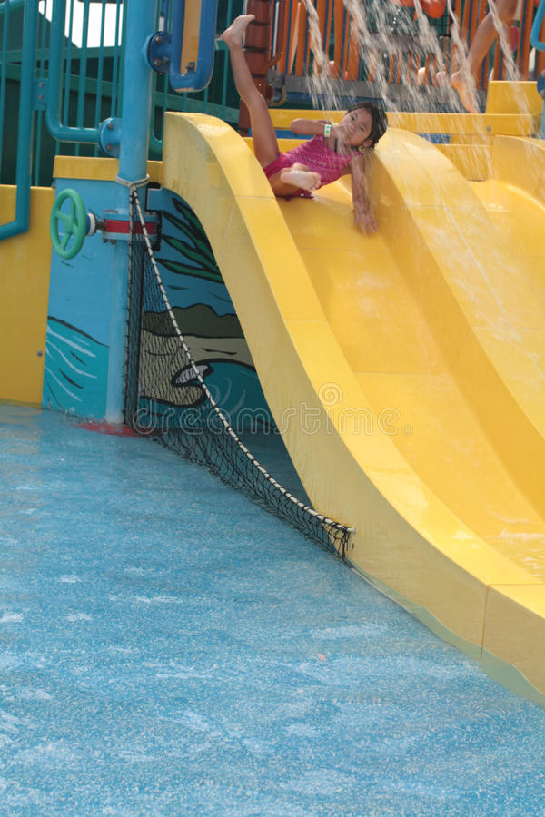 Girl on water slide royalty free stock image