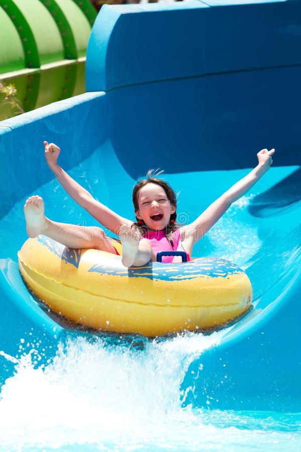 Download Girl on water slide stock photo. Image of inflatable - 20341616