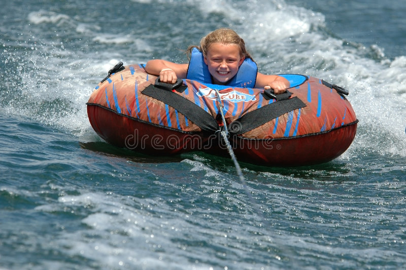 Girl Water Tubing with a Smile royalty free stock photography