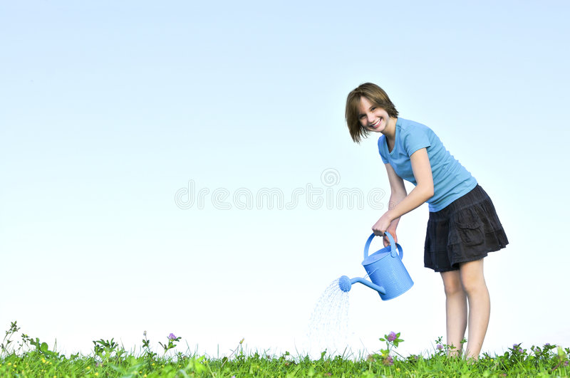 Download Girl With Watering Can Stock Photography - Image: 7079462