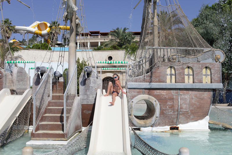 Girl on waterslide stock image