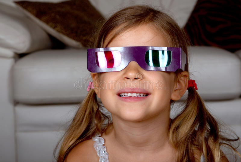 Download Girl wearing 3D glasses stock image. Image of looking - 15785271