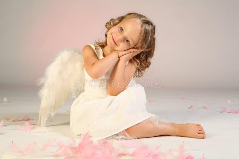 Girl wearing angel wings royalty free stock photos