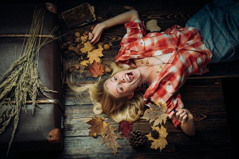 Girl wearing in autumn clothes on autumn sunny day. Beautiful sensual blonde. Happy young woman are preparing for autumn royalty free stock image