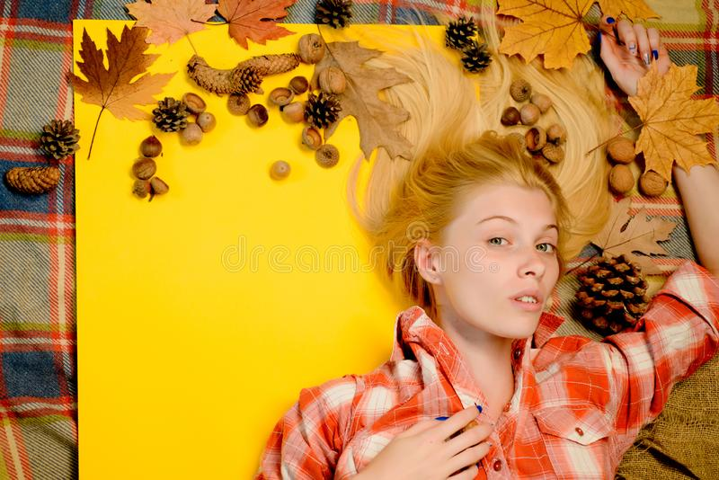 Girl wearing in autumn clothes on autumn sunny day.Happy young woman are preparing for autumn sunny day. Leaf fall royalty free stock image