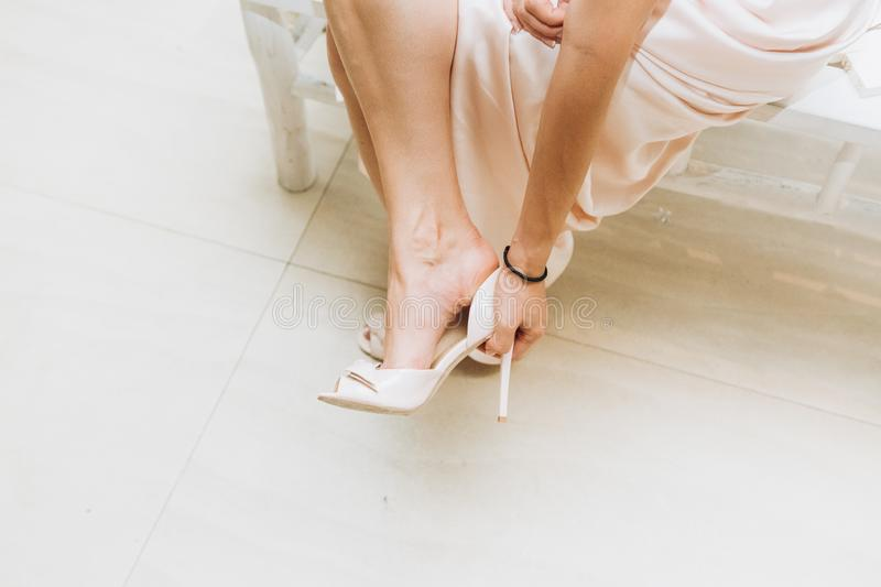 Girl wearing beige sandals thin high heels royalty free stock image