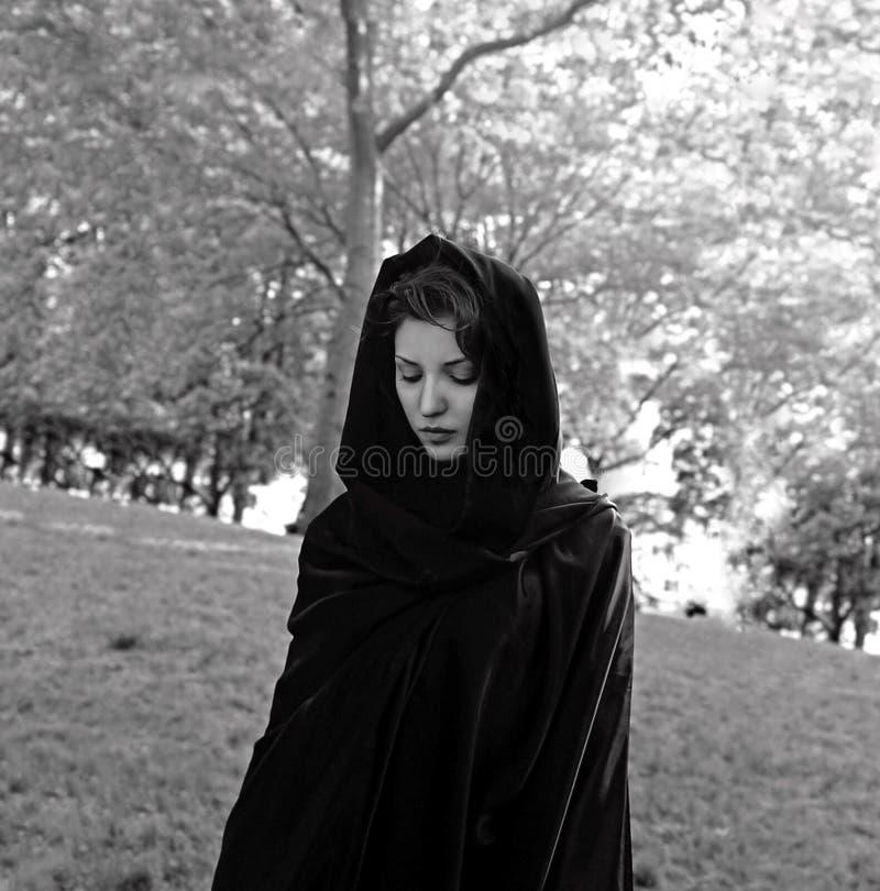 Girl wearing cloak stock images