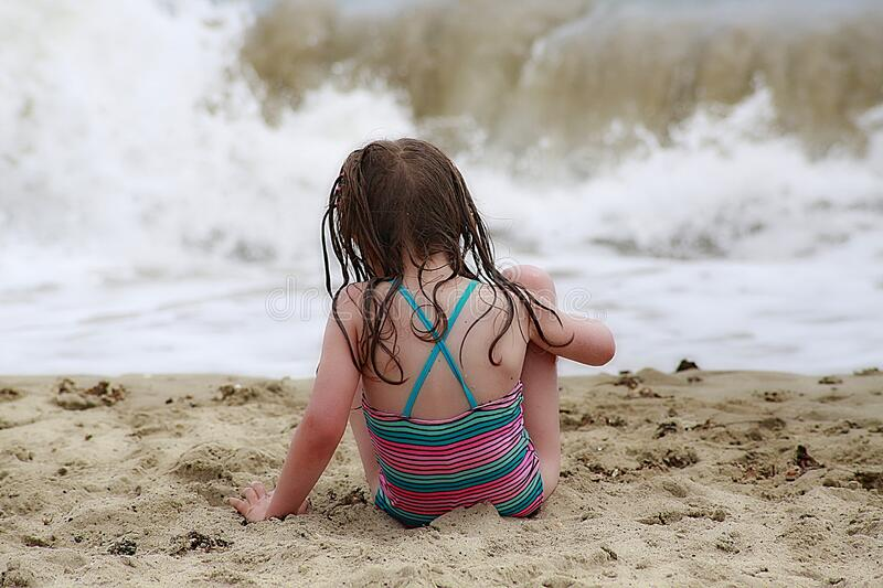 Girl Wearing Colorful Halter Top Swim Wear Sitting On A Brown Sand Free Public Domain Cc0 Image