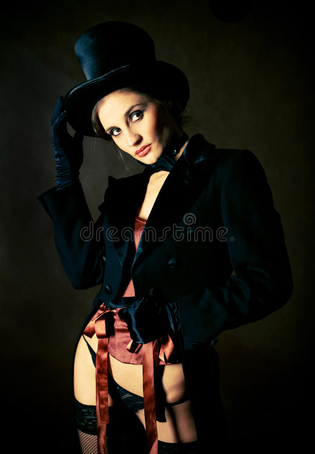 Girl wearing a cylinder hat royalty free stock images