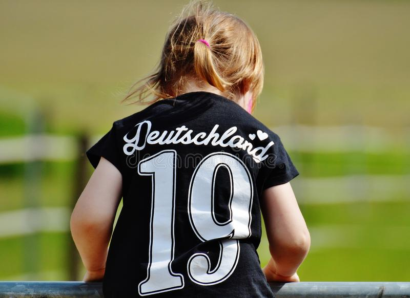 Girl Wearing Deutschland 19 Black T Shirt during Daytime stock photos