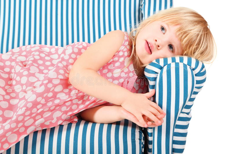Download Girl Wearing Dress Is Lying On Comfortable Chair Stock Photo - Image: 15512282