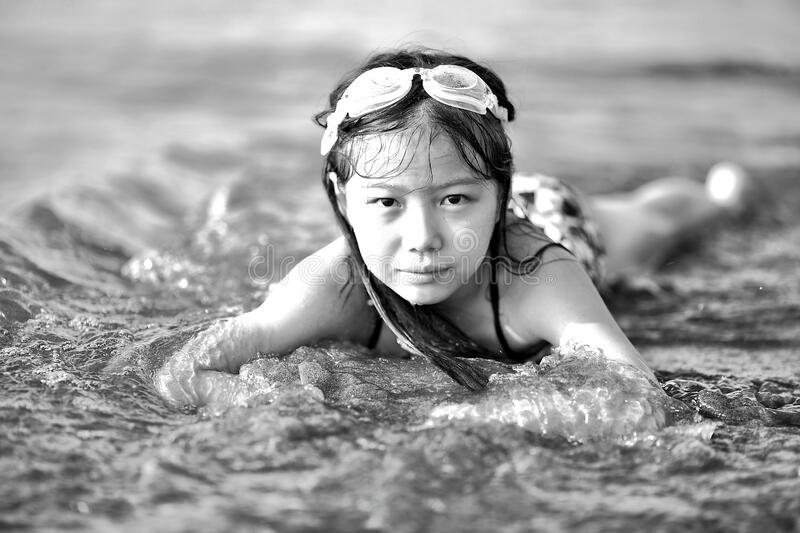 Girl Wearing Goggles on Beach in Black and White stock photo