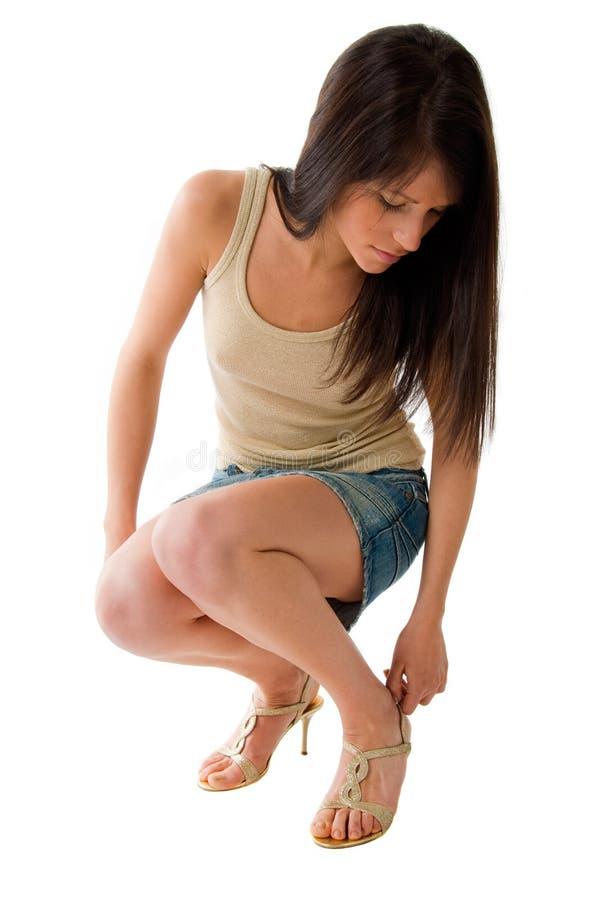 Girl wearing miniskirt stock photo