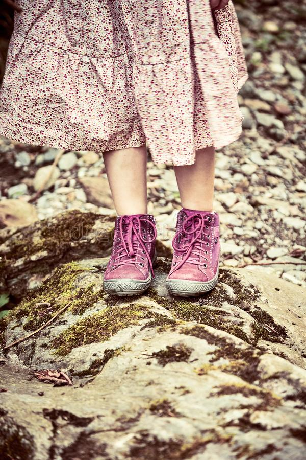 Girl wearing a pink dress and matching boots royalty free stock image