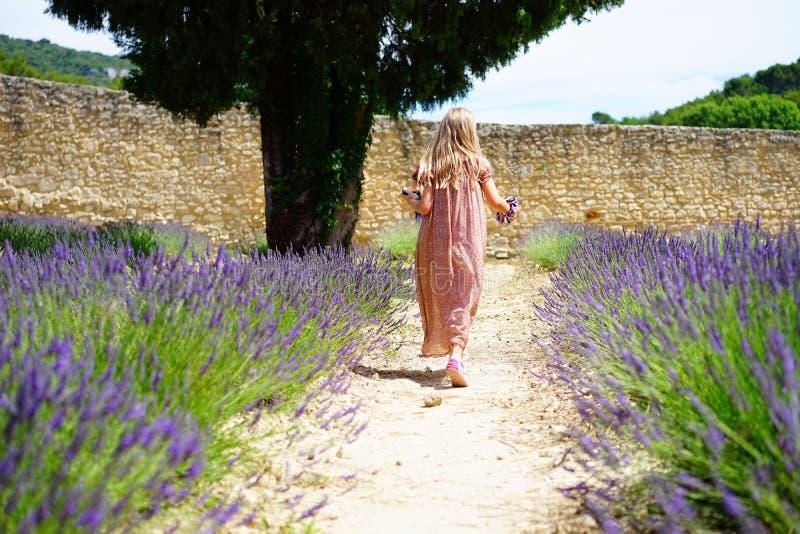 Girl Wearing Pink Dress Running On Trail Between Purple Flower Field Free Public Domain Cc0 Image