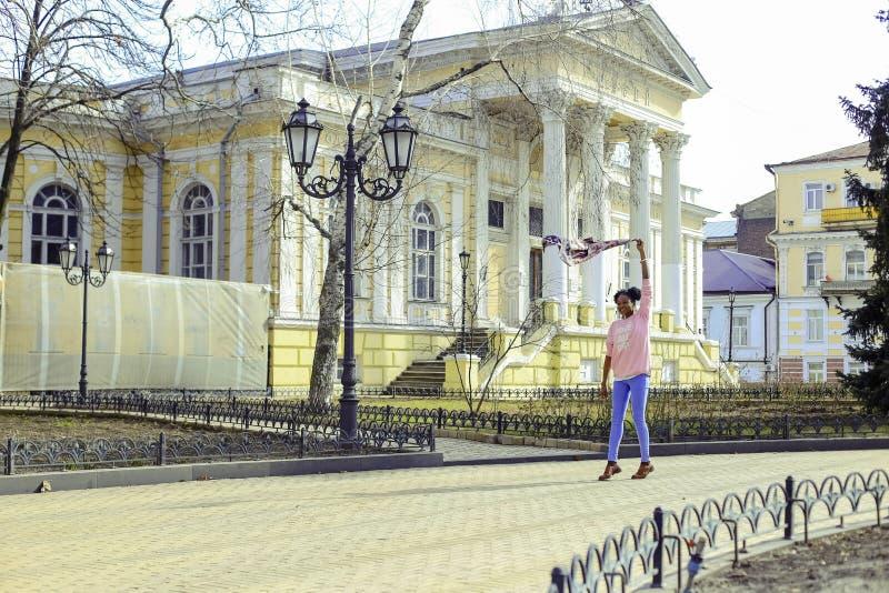 Girl Wearing Pink Long-sleeved Shirt and Blue Pants at Street royalty free stock photo