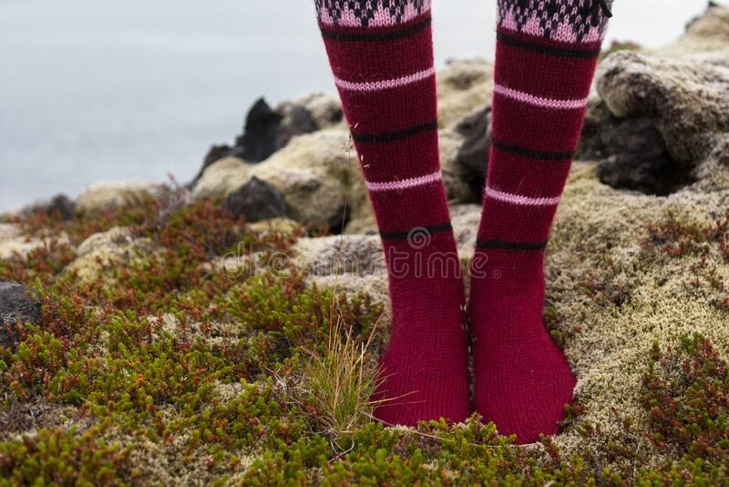 Girl wearing red Icelandic wool socks standing in. royalty free stock photos
