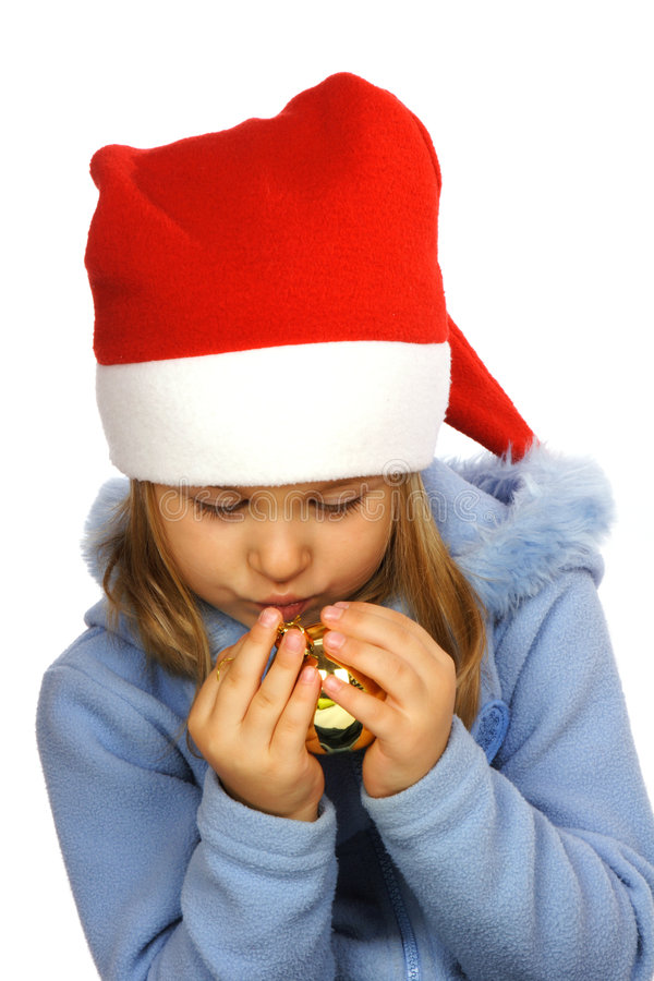 Girl wearing a Santa hat stock photography