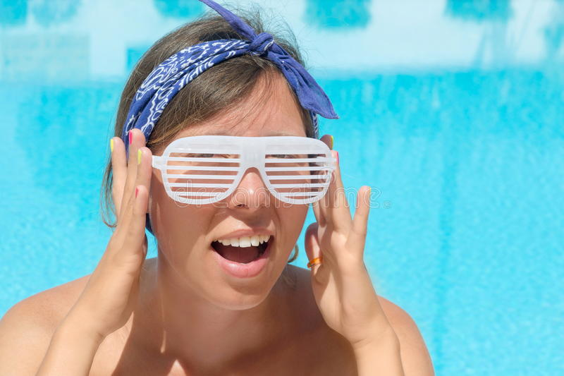 Girl wearing shutter shades royalty free stock photography