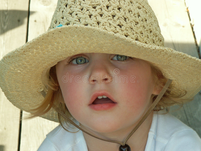 Girl Wearing Sun Hat Royalty Free Stock Photography
