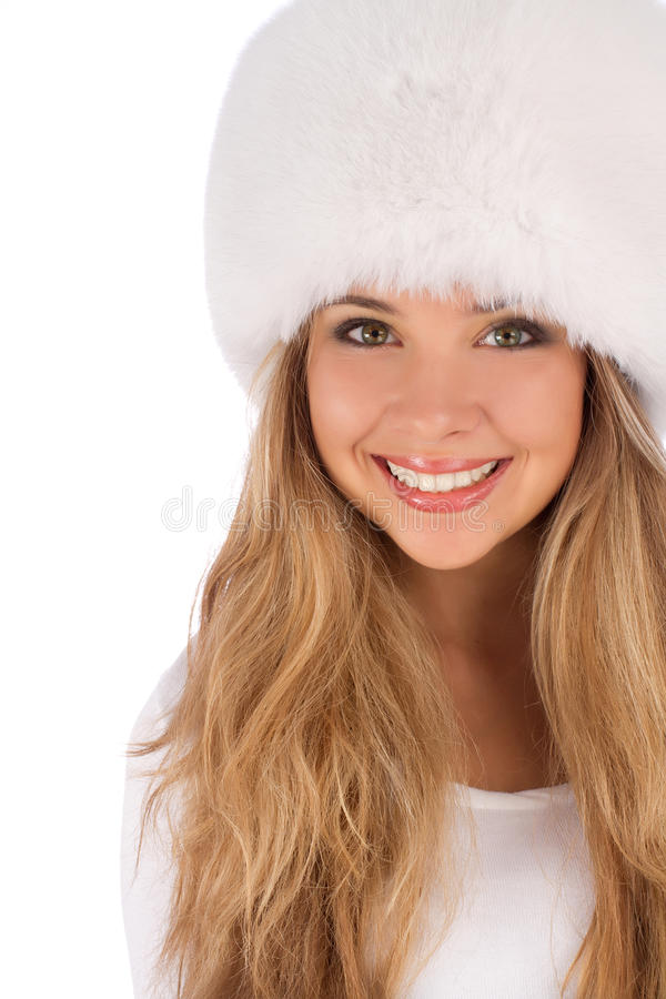 Girl wearing white fur hat looking up and left stock photo