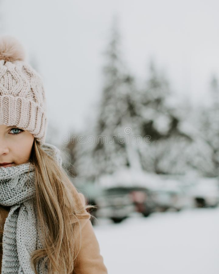 Girl Wearing Winter Outfit on Snowy Field stock image