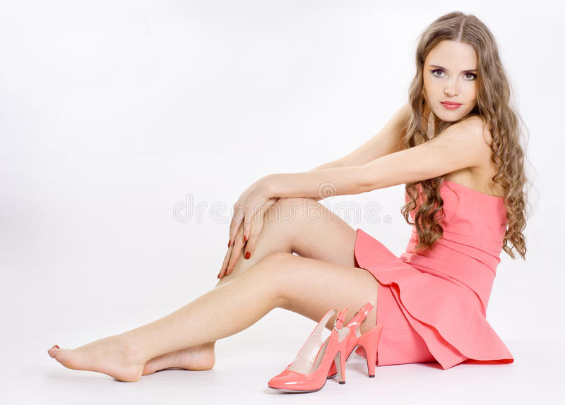 The girl wears a shoe, royalty free stock photo
