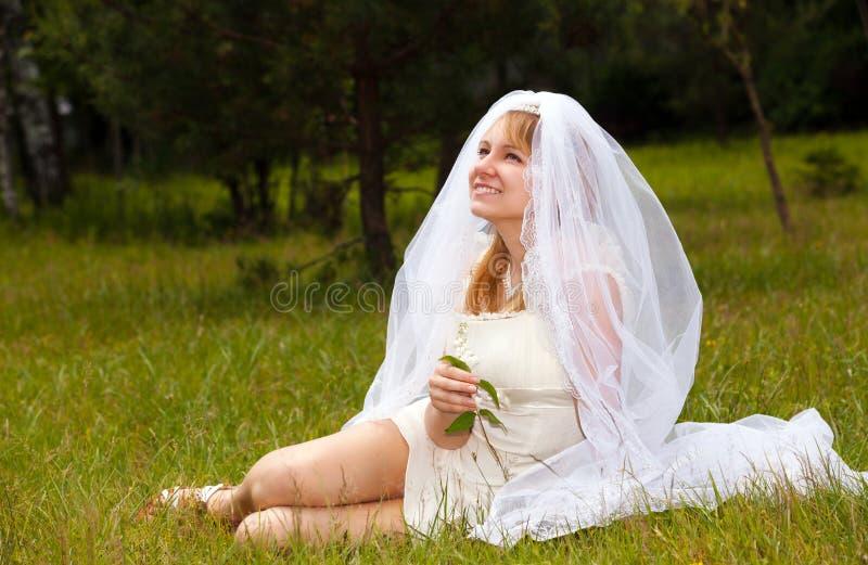 Girl in wedding dress in park royalty free stock photos