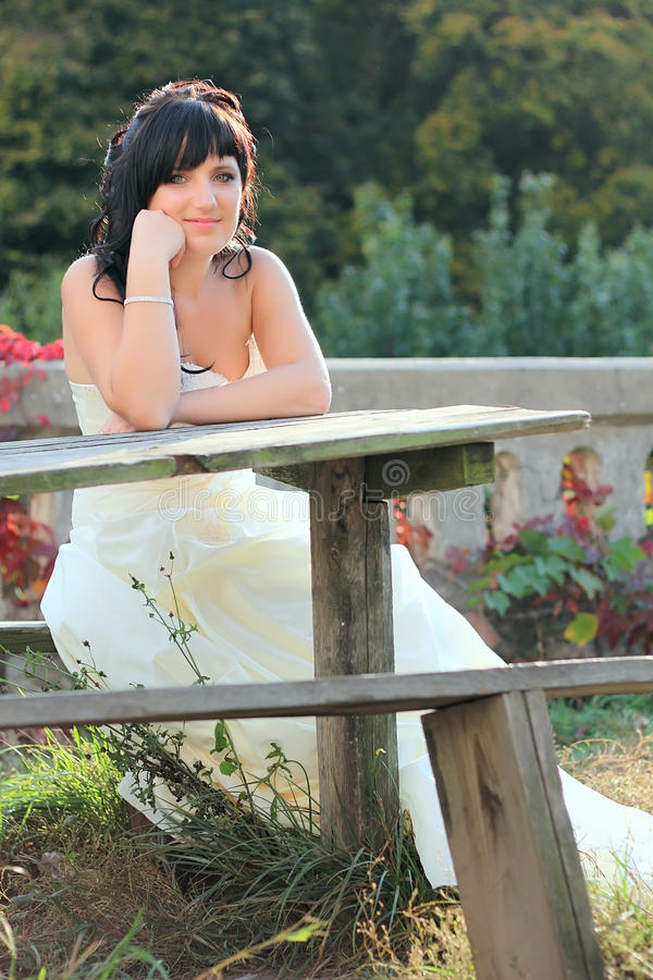 Download Girl In The Wedding Dress Sitting On The Bench Stock Image - Image: 28731797